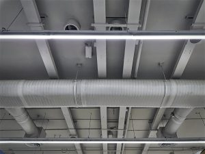 Low Angle View of Air Conditioning Ducts and Piping with Illumination